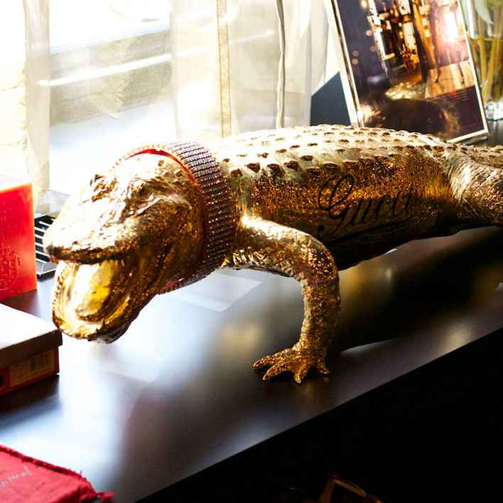 Gold Gucci alligator from Cindy's Black Apartment.